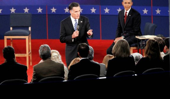 President Barack Obama, left, listens as Republican presidential candidate former Massachusetts Gov. Mitt Romney answers a question from a member of the audience. (AP Photo/Mary Altaffer)