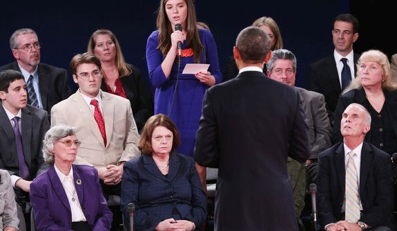 A member of the audience asks President Barack Obama a question during the second presidential debate with Republican presidential nominee Mitt Romney. (AP Photo/Pool-Win McNamee)