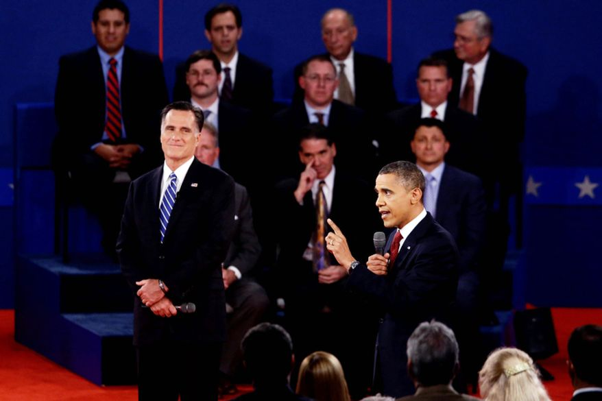 President Barack Obama and Republican presidential candidate and former Massachusetts Gov. Mitt Romney participate in the second presidential debate. (AP Photo/Charles Dharapak)