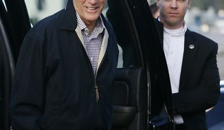 Republican presidential candidate Mitt Romney exits his vehicle Oct. 16, 2012, before boarding his campaign plane in Bedford, Mass. (Associated Press)