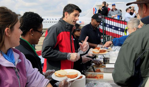 Republican vice presidential candidate, Rep. Paul Ryan, R-Wis., center, serves up Montgomery Inn barbeque, Monday, Oct. 15, 2012, during a campaign stop at Lunken Airport in Cincinnati. (AP Photo/Al Behrman)