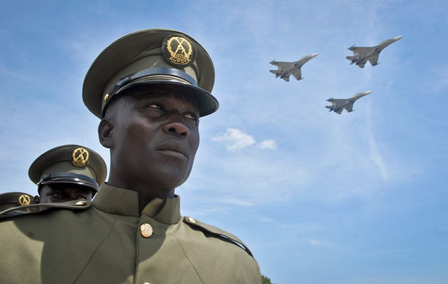 **FILE** Ugandan jets fly past Oct. 9, 2012, during a military parade in Kampala, Uganda, held by the Uganda People's Defence Force to celebrate the 50th anniversary of the country's independence from British rule. (Associated Press)