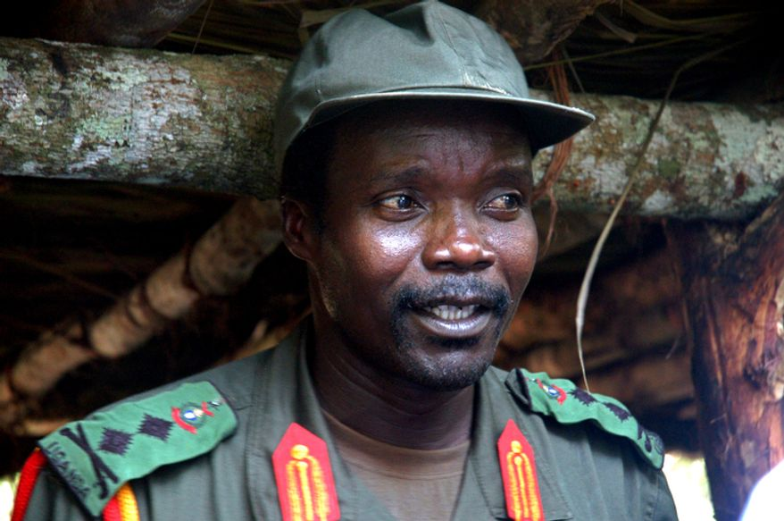 **FILE** Joseph Kony, leader of the Lord's Resistance Army, meets July 31, 2006, with a delegation of 160 officials and lawmakers from northern Uganda and representatives of non-governmental organizations in Congo near the Sudan border. (Associated Press)