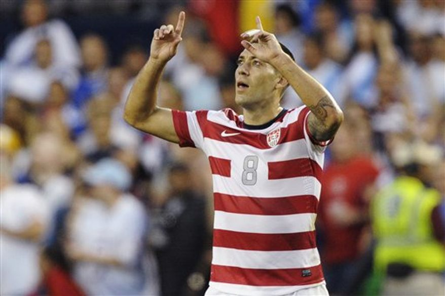 United States forward Clint Dempsey celebrates after scoring against Guatemala during the first half of a World Cup qualifying soccer match in Kansas City, Kan., Tuesday, Oct. 16, 2012. (AP Photo/Reed Hoffmann)