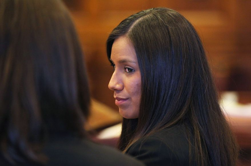**FILE** Alexis Wright, 29, turns towards her attorney Sarah Churchill (left) during her arraignment Oct. 9, 2012, in Portland, Maine, for allegedly providing sex for money at her Kennebunk fitness studio and office. (Associated Press)