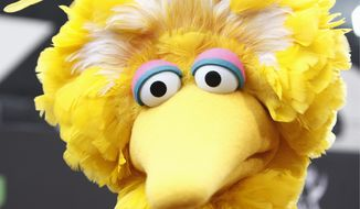 An 8-foot-tall bright-yellow bird became the unlikeliest character in the presidential race this month when Republican Mitt Romney suggested, during the first presidential debate, cutting off federal subsidies for Big Bird. (Associated Press)
