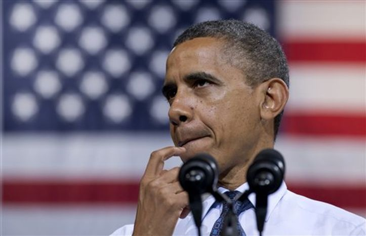 President Barack Obama pauses as he speaks at a campaign event at George Mason University, Friday, Oct. 5, 2012, in Fairfax, Va. (AP Photo/Carolyn Kaster)