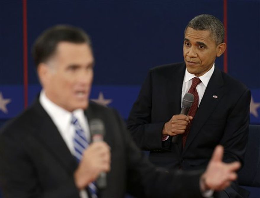 President Barack Obama listens as Republican presidential nominee Mitt Romney speaks during the second presidential debate at Hofstra University, Tuesday, Oct. 16, 2012, in Hempstead, N.Y. (AP Photo/Eric Gay)