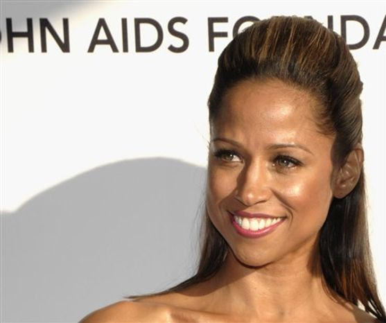 FILE - In this Sunday, March 7, 2010, file photo Stacey Dash arrives at the Elton John Oscar Party in West Hollywood, Calif. Dash, who tweeted an endorsement of Romney, was subjected to a stream of abuse from other African-Americans. (AP Photo/Dan Steinberg)