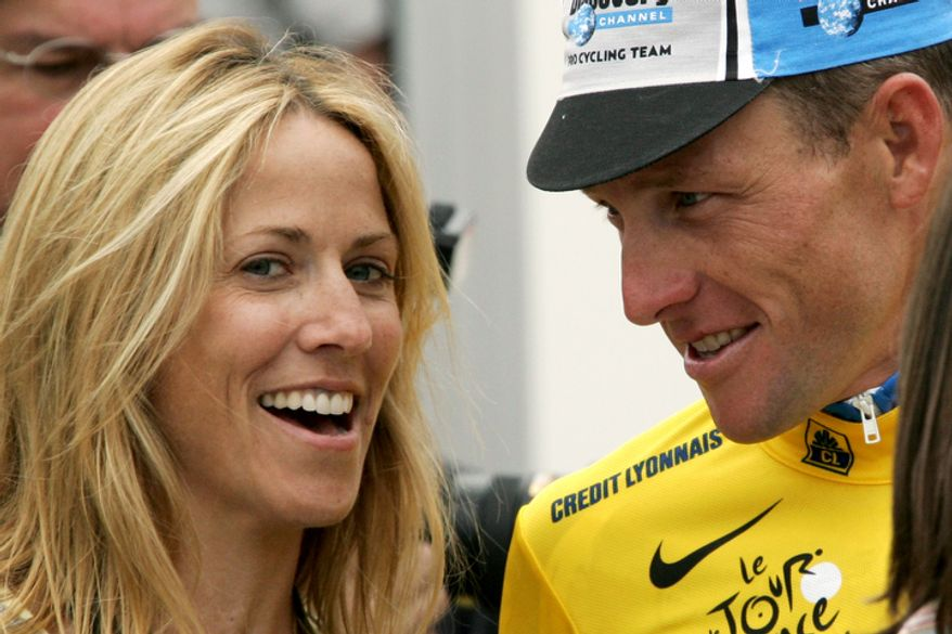 Six-time Tour de France winner Lance Armstrong of Austin, Texas, right, wearing the overall leader's yellow jersey, looks at his girlfriend, singer Sheryl Crow, after the Discovery Channel cycling team won the fourth stage of the Tour de France cycling race, a 67.5-kilometer (41.95-mile) team time trial between Tours and Blois, western France, Tuesday, July 5, 2005. Armstrong took the lead from compatriot David Zabriskie on Tuesday. (AP Photo/Christophe Ena)