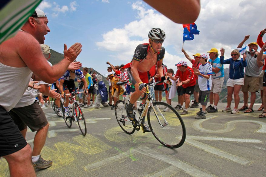 Lance Armstrong of the United States leads the breakaway group of cyclists as they climb toward Tourmalet Pass during the 16th stage of the Tour de France cycling race over 124 miles, with a start in Bagneres-de-Luchon and finish in Pau in the Pyrenees region of France, on Tuesday, July 20, 2010. (AP Photo/Bas Czerwinski)
