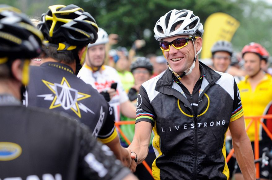 Cyclist Lance Armstrong greets fellow riders before the start of his Livestrong Challenge 10K ride for cancer in Blue Bell, Pa., on Aug. 22, 2010. (AP Photo/Bradley C. Bower)