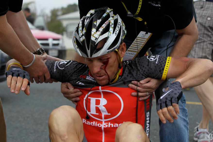 Lance Armstrong is pictured after crashing during the fifth stage of the Tour of California cycling race in the outskirts of Visalia, Calif., on Thursday, May 20, 2010. (AP Photo/Marcio Jose Sanchez)