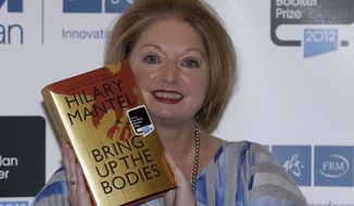 "Hilary Mantel, winner of the Man Booker Prize for Fiction, poses with a copy of her book ""Bring Up the Bodies,"" shortly after the award ceremony in central London on Tuesday, Oct. 16, 2012. Miss Mantel received 50,000 British pounds ($80,000) for her second Booker win. (AP Photo/Lefteris Pitarakis)"