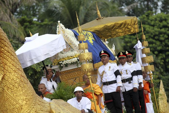 A phoenixlike float with the casket carrying the body of former Cambodian King Norodom Sihanouk arrives at the Royal Palace in Phnom Penh, Cambodia, as mourners lining the streets pay their respects on Wednesday, Oct. 17, 2012. (AP Photo/Wong Maye-E)