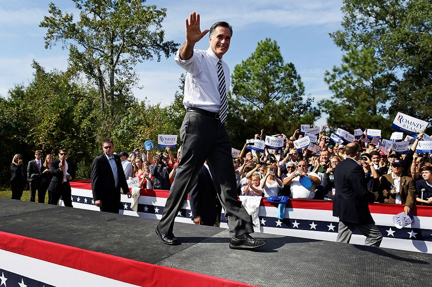 Republican presidential candidate Mitt Romney waves Oct. 17, 2012, as he arrives for a campaign stop at Tidewater Community College in Chesapeake, Va. (Associated Press)