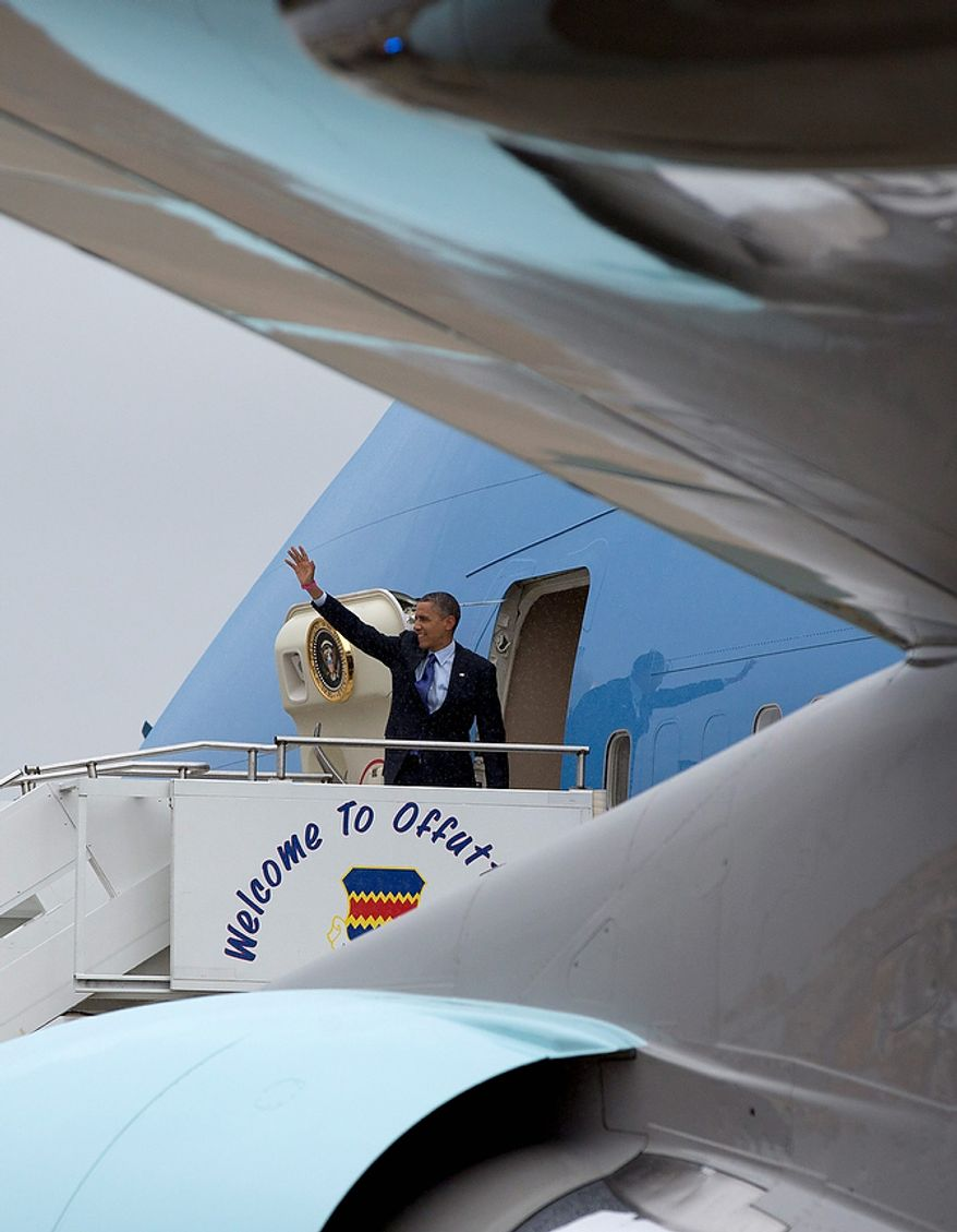 President Obama waves Oct. 17, 2012, as he boards Air Force One at Eastern Iowa Airport in Cedar Rapids, Iowa, en route to Columbus, Ohio, for another campaign stop. (Associated Press)