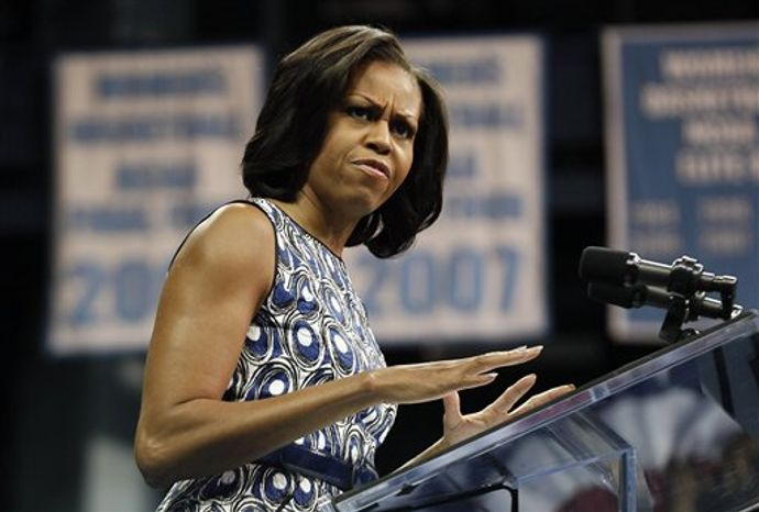 ** FILE ** First lady Michelle Obama speaks during a visit to Chapel Hill, N.C., on Oct. 16, 2012. (AP Photo/Gerry Broome)