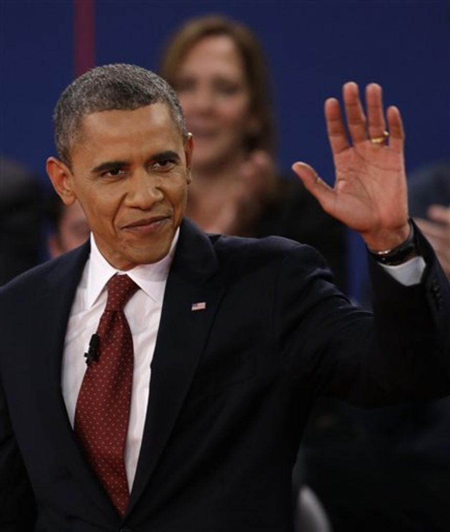 President Barack Obama waves as he arrives at the second presidential debate at Hofstra University, Tuesday, Oct. 16, 2012, in Hempstead, N.Y. (AP Photo/David Goldman)