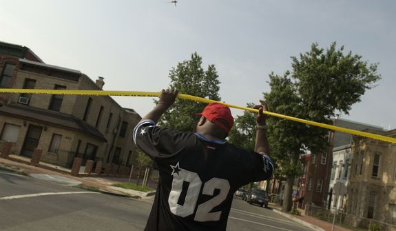 Leroy Thorpe walks around the Shaw neighborhood in NW, DC, Saturday, July 17,2004 pointing out former crack houses he, along with his Red Hat group, helped to shut down, turning the once crime ridden area into an area with homes going for a quarter of a million dollars. ( Mary F. Calvert / The Washington Times )