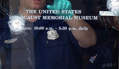 A metro police officer examine the gun shots at the crime scene at the United States Holocaust Memorial Museum  in Washington, D.C., Thursday, June 11, 2009, where a security guard was killed during a shooting yesterday. (Astrid Riecken/The Washington Times)