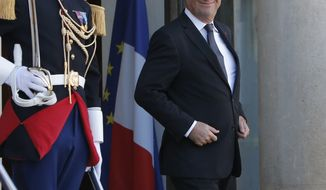 France's President Francois Hollande waits for the arrival of Quebec Prime Minister Pauline Marois prior to their meeting at the Elysee Palace in Paris, Monday, Oct. 15, 2012. (AP Photo/Francois Mori)