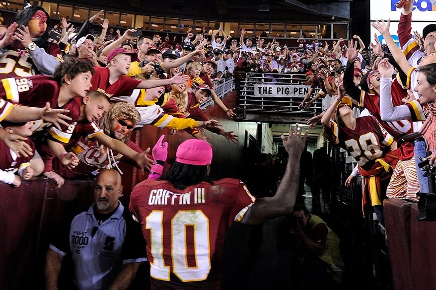 Washington Redskins quarterback Robert Griffin III (10) leaves the field after providing the Redskins their first home victory in nine games at FedEx Field, Landover, Md., Oct. 14, 2012. (Preston Keres/Special to The Washington Times)