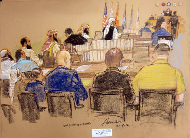 In this photo of a sketch by courtroom artist Janet Hamlin and reviewed by the U.S. Department of Defense, the five Guantanamo prisoners charged in the Sept. 11 attacks, back row from left, Mustafa Ahmad al-Hawsawi, Ali Abd al-Aziz Ali, Ramzi Binalshibh, Walid bin Attash and the alleged mastermind Khalid Sheik Mohammed, attend their Military Commissions pretrial hearing in the Guantanamo Bay U.S. Naval Base in Cuba, Monday, Oct. 15, 2012. The five accused of the Sept. 11 attacks were back before a military tribunal, forgoing the protest that turned their last appearance into an unruly 13-hour spectacle. (AP Photo/Janet Hamlin, Pool)