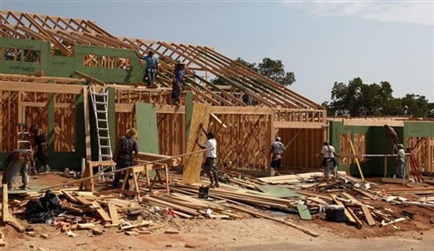 In this Friday, Sept. 21, 2012, photo, new homes are constructed in Edmond, Okla. U.S. builders started construction on single-family homes and apartments in September at the fastest rate since July 2008, a further indication that the housing recovery is strengthening. (AP Photo/Sue Ogrocki,)