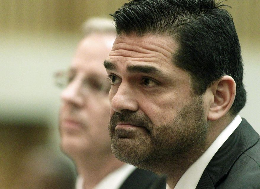 ** FILE ** Los Angeles County Assessor John Noguez (right) speaks before county supervisors at their weekly meeting in Los Angeles on Tuesday, April 10, 2012. (AP Photo/Los Angeles Times, Brian van der Brug)