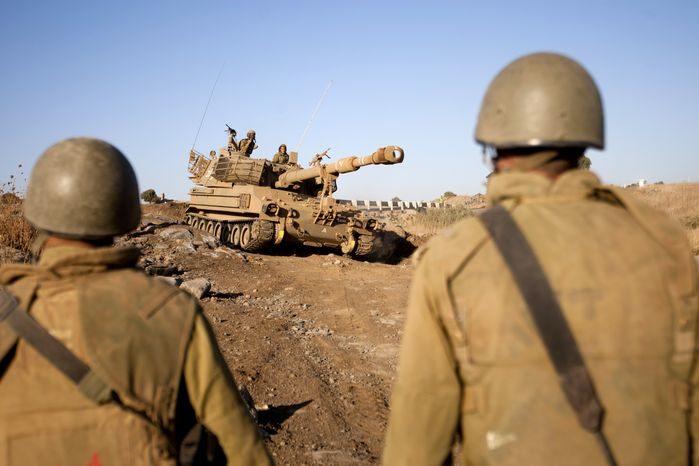 ** FILE ** Israeli soldiers conduct a military exercise in the Israeli-controlled part of the Golan Heights, captured from neighboring Syria in the 1967 war, on Wednesday, Sept. 19, 2012. The exercise was Israel's largest snap drill in years as tensions with Iran over its nuclear program rise and civil war in neighboring Syria rages. (AP Photo/Ariel Schalit)
