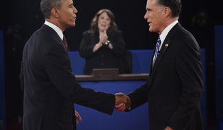 Moderator Candy Crowley (center) of CNN applauds as President Obama (left) and Republican presidential nominee Mitt Romney shake hands during the second presidential debate, at Hofstra University on Tuesday, Oct. 16, 2012, in Hempstead, N.Y. (AP Photo/Michael Reynolds, Pool)