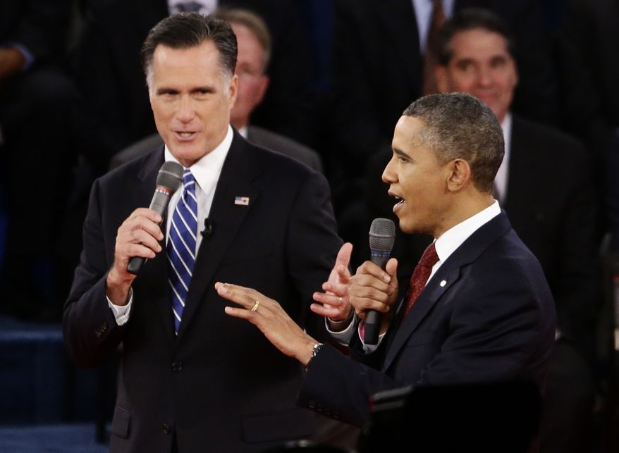 President Barack Obama and Republican presidential candidate and former Massachusetts Gov. Mitt Romney speak during the second presidential debate at Hofstra University in Hempstead, N.Y., Tuesday, Oct. 16, 2012. (AP Photo/Charles Dharapak)