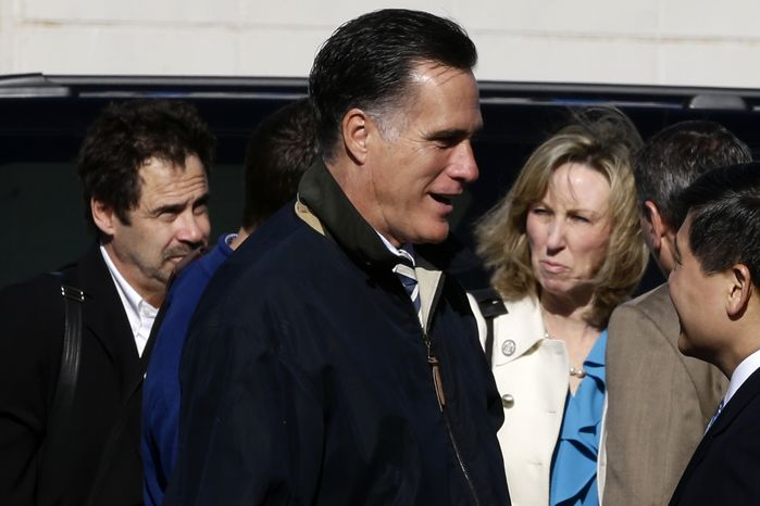 Republican presidential candidate Mitt Romney walks Oct. 17, 2012, with comedian Dennis Miller (left) and senior adviser Barbara Comstock before boarding his campaign plane in Ronkonkoma, N.Y. (Associated Press)