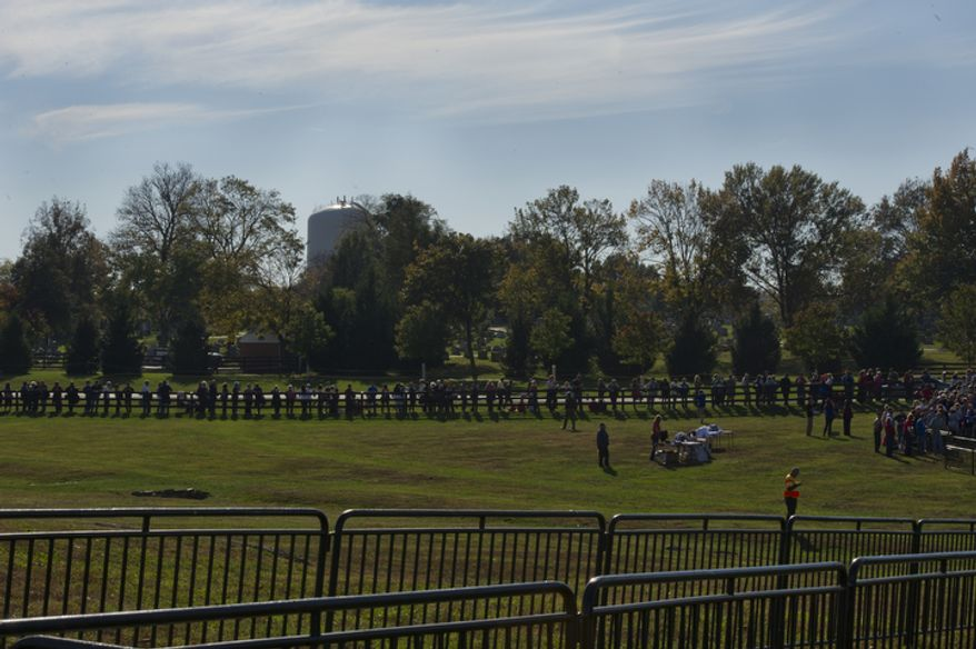 A crowd lines up Oct. 17, 2012, outside of Ida Lee Park in Leesburg, Va., to participate in a rally for GOP presidential candidate Mitt Romney. (Barbara L. Salisbury/The Washington Times)