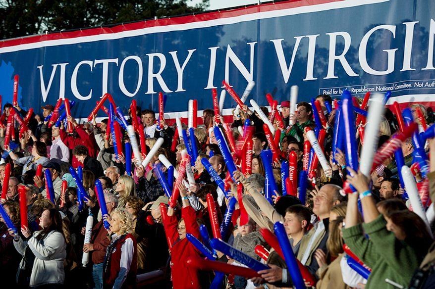 "Mitt Romney supporters wave ""thunder sticks"" during a rally at Ida Lee Park. (Barbara L. Salisbury/The Washington Times)"