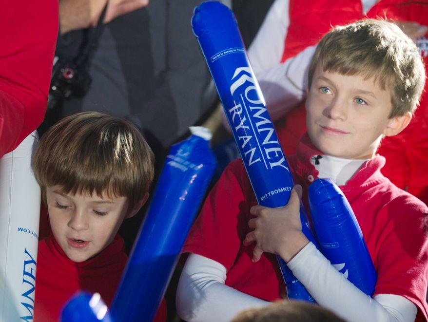 "CJ Czwartacki, left, 6, and his brother Sam, 10, hold ""thunder sticks"" during the Mitt Romney rally at Ida Lee Park in Leesburg, Va. on Wednesday, Oct. 17, 2012. (Barbara L. Salisbury/The Washington Times)"