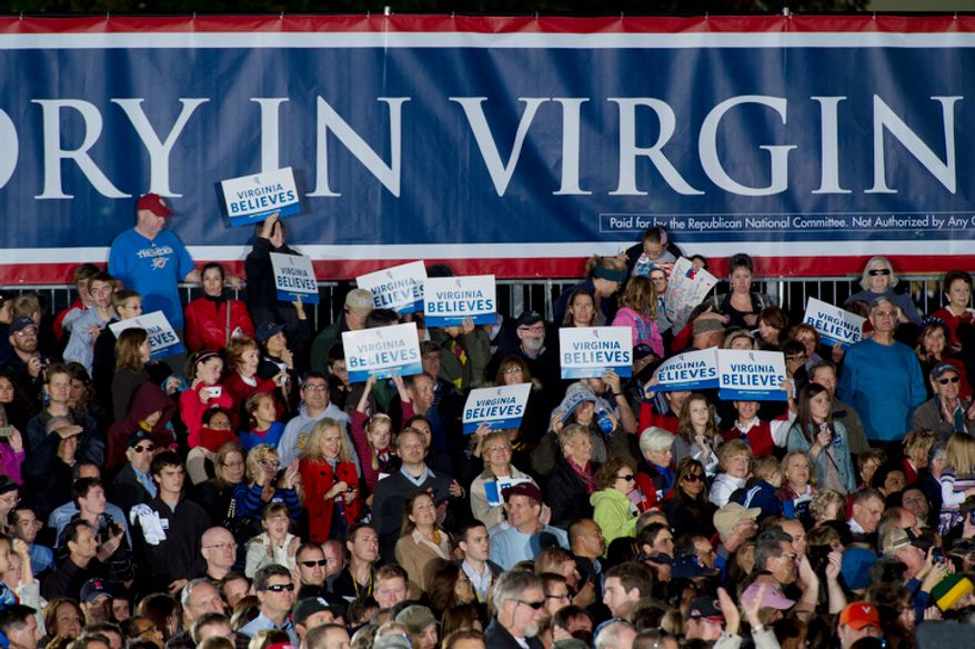 Virginia supporters hold signs for GOP presidential candidate Mitt Romney during a rally at Ida Lee Park in Leesburg, Va. on Wednesday, Oct. 17, 2012. (Barbara L. Salisbury/The Washington Times)
