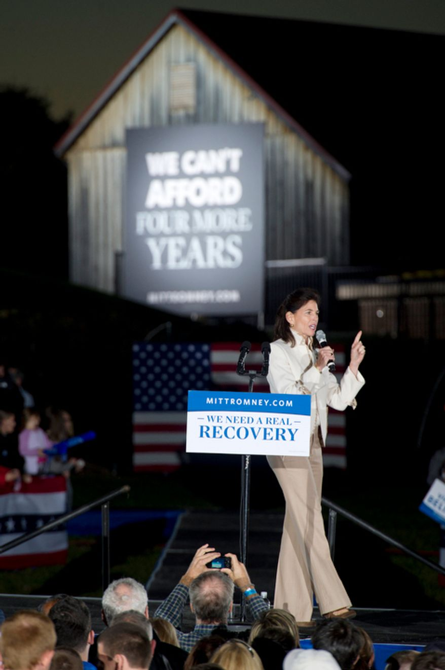 George Allen's wife Susan campaigns for her husband and supports the Republican ticket during a rally for GOP presidential candidate Mitt Romney at Ida Lee Park in Leesburg, Va. on Wednesday, Oct. 17, 2012. (Barbara L. Salisbury/The Washington Times)