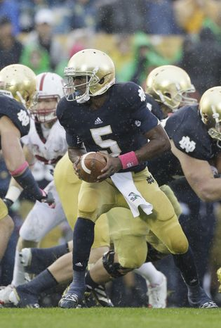 Notre Dame quarterback Everett Golson (5) looks to a pass during the first half of an NCAA college football game against Stanford in South Bend, Ind., Saturday, Oct. 13, 2012. (AP Photo/Nam Y. Huh)