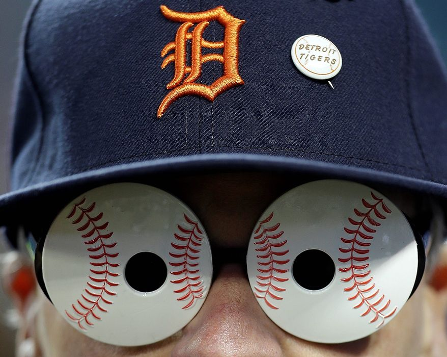 Dennis Belkowski watches the New York Yankees take batting practice before Game 3 of the American League championship series against the Detroit Tigers Tuesday, Oct. 16, 2012, in Detroit. (AP Photo/Paul Sancya )