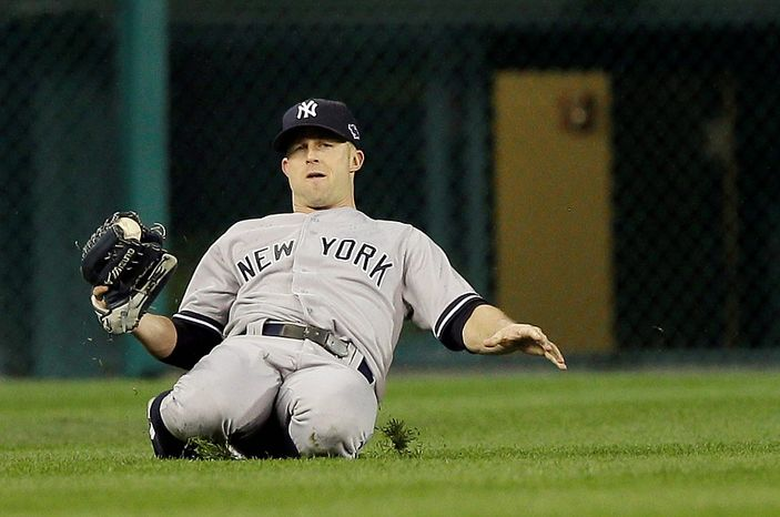 New York Yankees' Brett Gardner makes a catch on a ball hit by Detroit Tigers' Jhonny Peralta in the eighth inning during Game 3 of the American League championship series Tuesday, Oct. 16, 2012, in Detroit. (AP Photo/Matt Slocum)