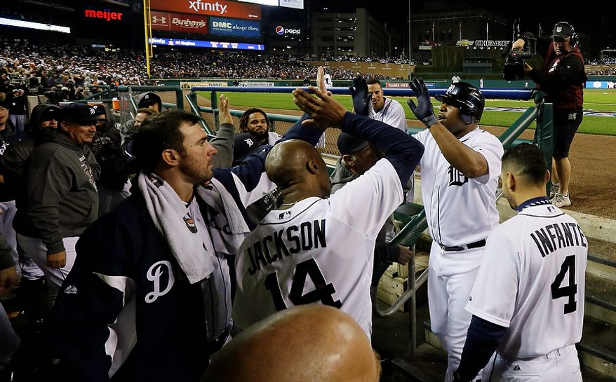 Detroit Tigers' Delmon Young is congratulated by teammates after hitting a home run in the fourth inning during Game 3 of the American League championship series against the New York Yankees Tuesday, Oct. 16, 2012, in Detroit. (AP Photo/Matt Slocum)