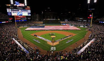 Marvin Winans sings the national anthem before the start of  Game 3 of the American League championship series between the New York Yankees and Detroit Tigers Tuesday, Oct. 16, 2012, in Detroit. (AP Photo/Carlos Osorio)