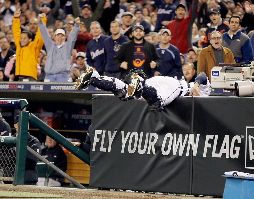 Detroit Tigers' Alex Avila makes a catch on a foul ball hit by New York Yankees' Russell Martin in the second inning during Game 3 of the American League championship series Tuesday, Oct. 16, 2012, in Detroit. (AP Photo/Matt Slocum)