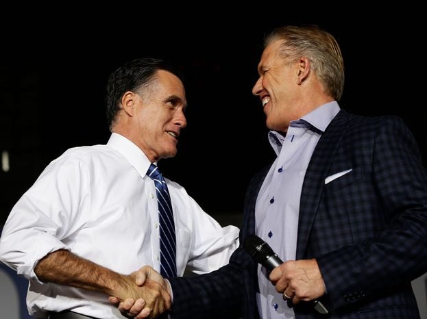 Former NFL quarterback John Elway arrives to campaign for Mitt Romney at Wings Over the Rockies Air and Space Museum in Denver earlier this month. (Associated Press)