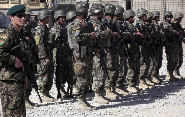 Members of the Afghan National Civil Order Police (ANCOP) line up to get counter-IED training at Forward Operating Base Warrior in the Gelan district of Afghanistan's Ghazni province on Wednesday, Oct. 10, 2012. (AP Photo/Robert Burns)