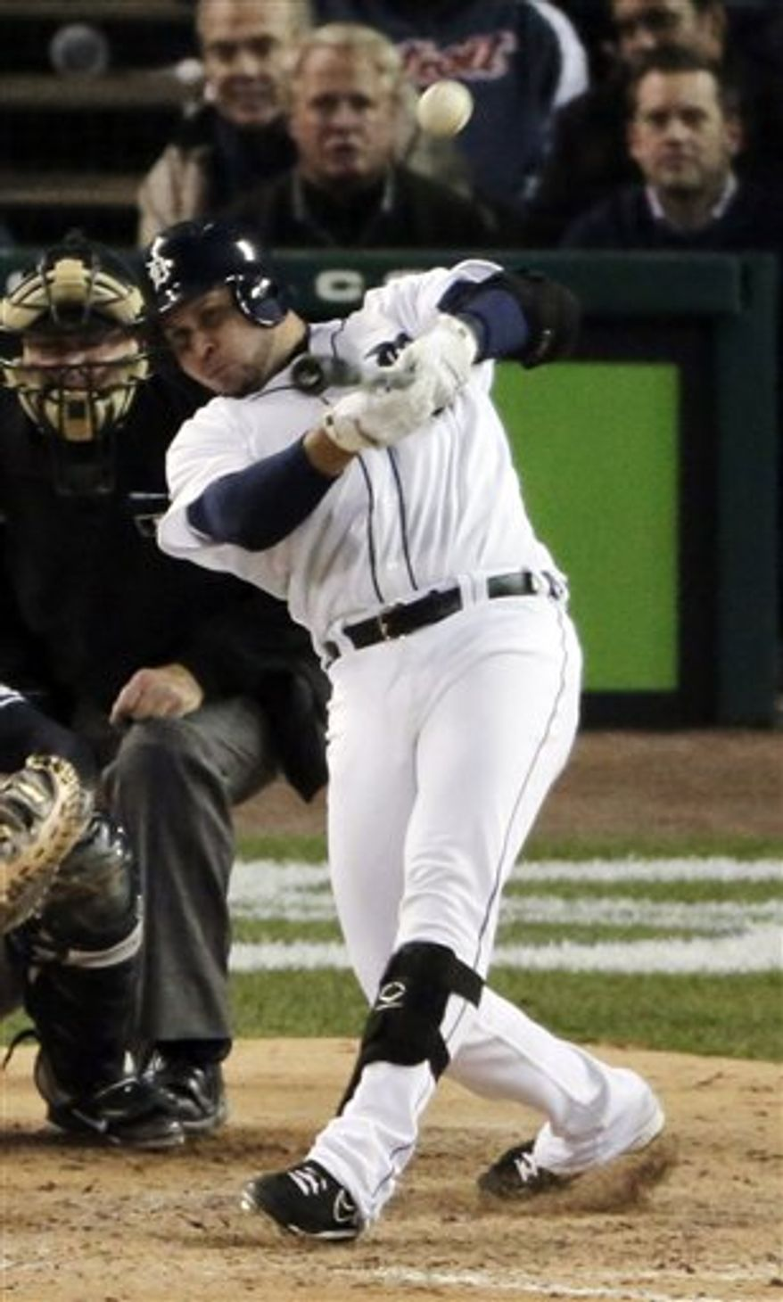 Detroit Tigers' Jhonny Peralta hits a home run in the eighth inning against the New York Yankees during Game 4 of the American League Championship Series Thursday, Oct. 18, 2012, in Detroit. The Tigers won 8-1 and move on to the World Series. (AP Photo/Charlie Riedel)