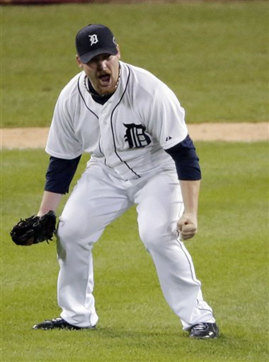Detroit Tigers' Phil Coke celebrates after winning Game 4 of the American League Championship Series against the New York Yankees Thursday, Oct. 18, 2012, in Detroit. The Tigers move on to the World Series. (AP Photo/Charlie Riedel)