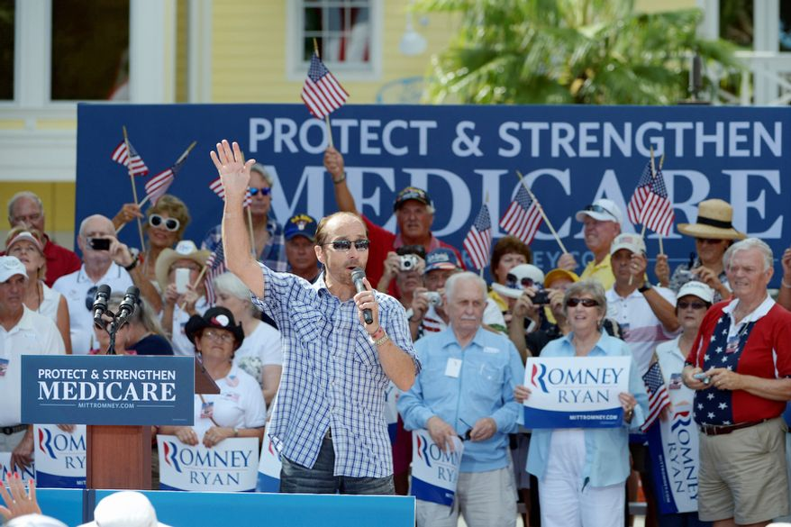 Entertainer Lee Greenwood performs before Republican vice presidential candidate Paul Ryan addresses supporters at a campaign rally in The Villages, Fla., on Aug. 18, 2012. (Associated Press